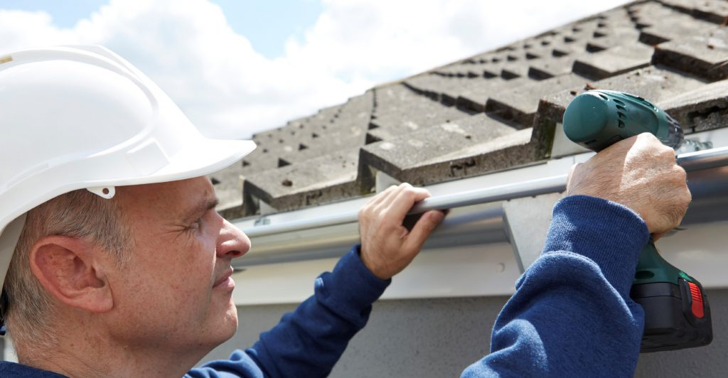 Man Installing Gutter | Gutter Replacement Fairfield CT