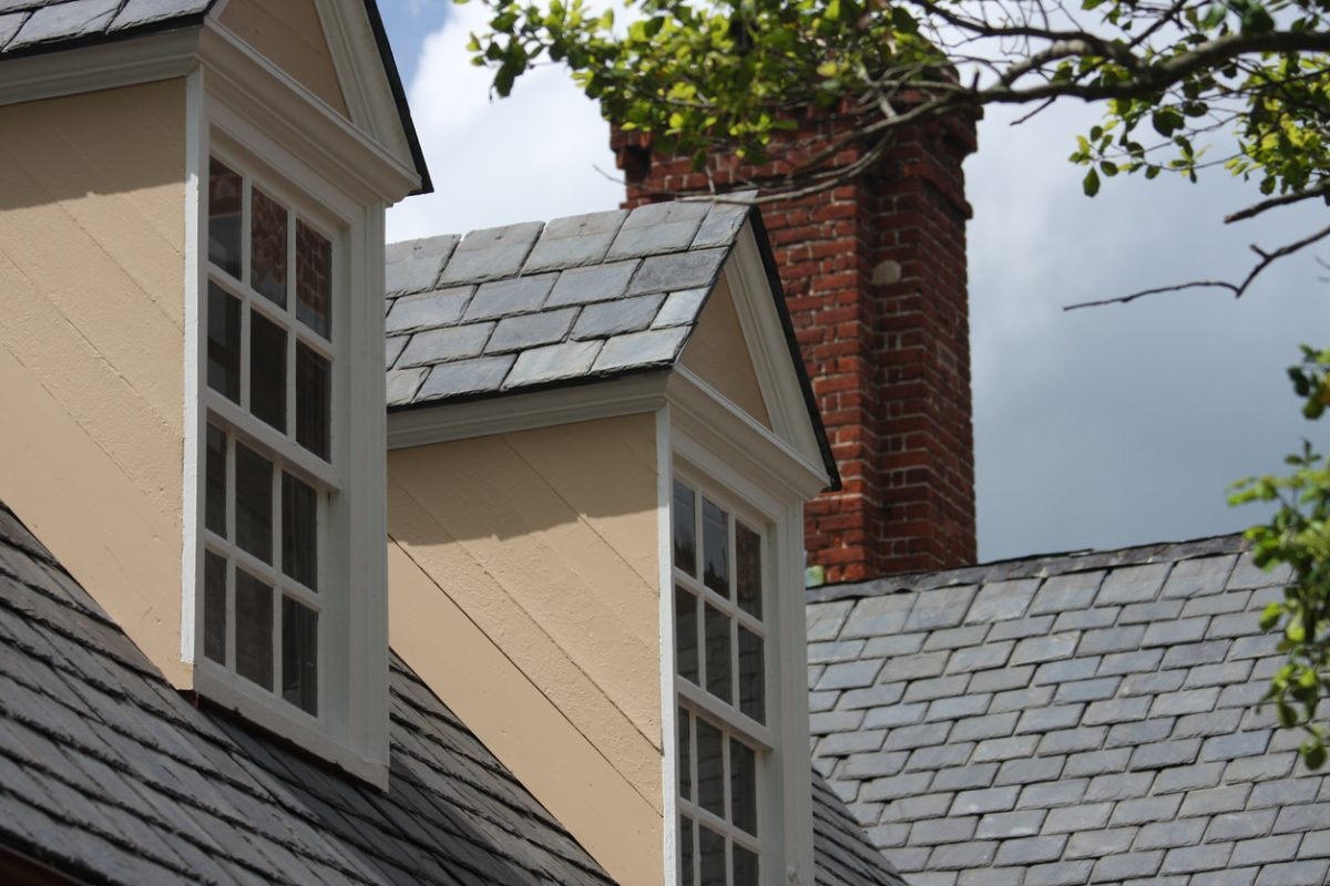 Windows of a home with slate tile roofing